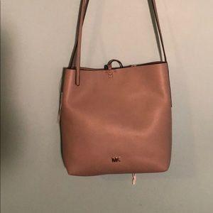 Gray M Kors handbag.